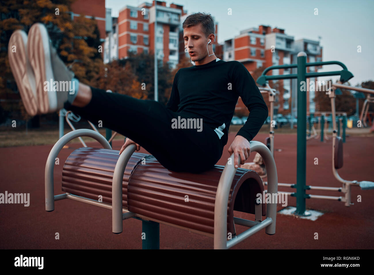 Sportive man working out in the evening - Stock Image