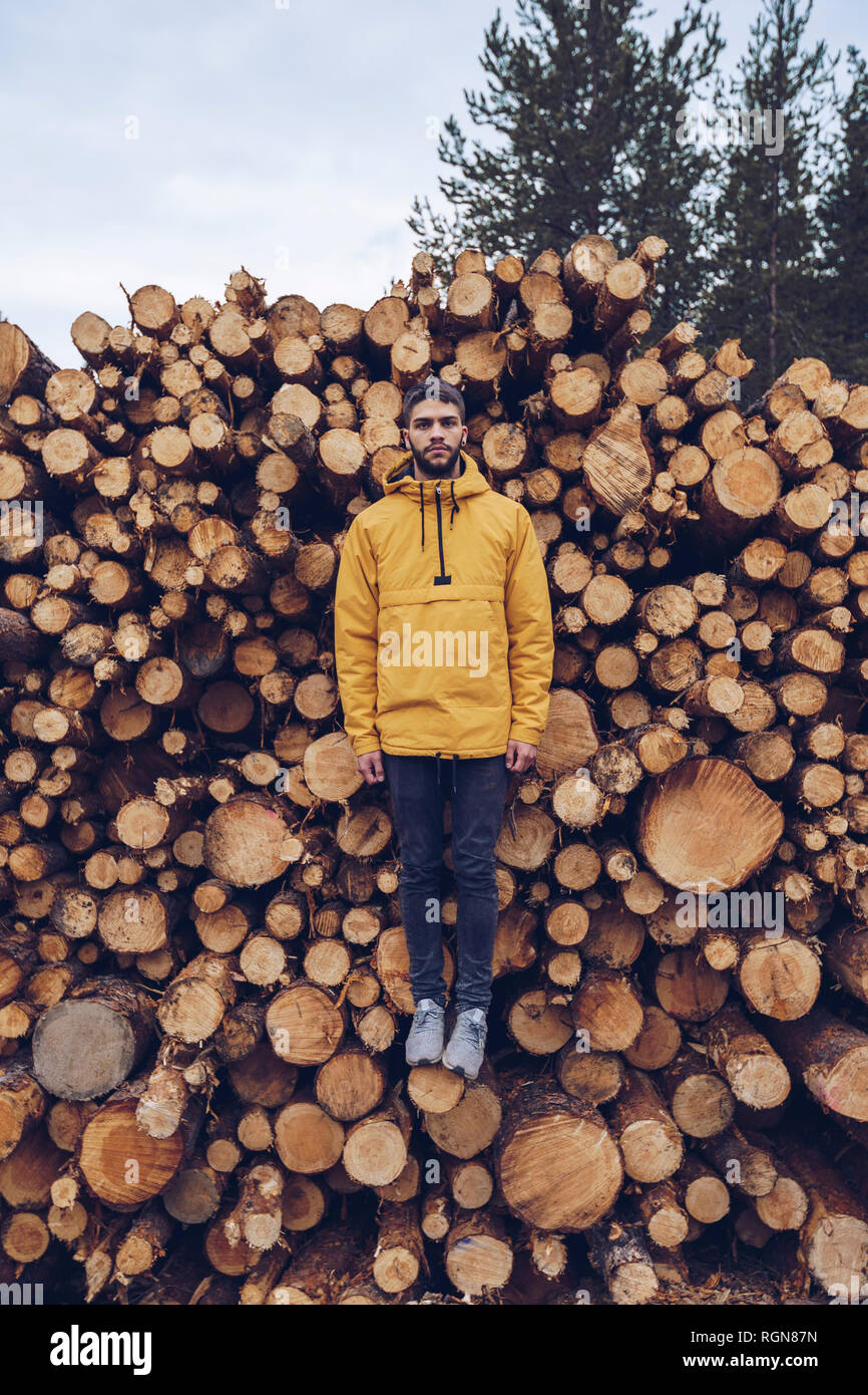 Young man standing on a stck of wood, giving the illusion of hovering Stock Photo
