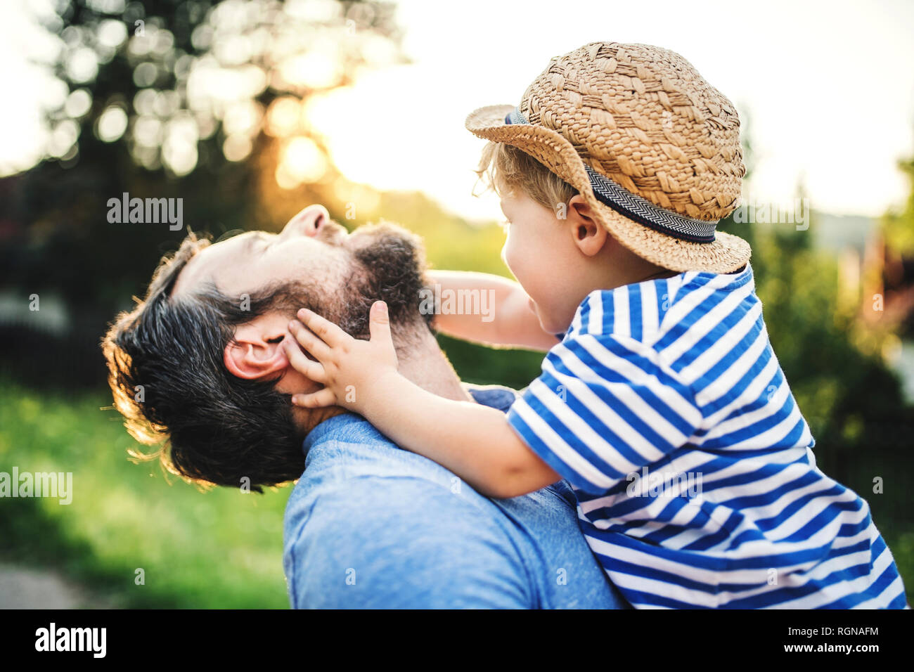 Little boy having fun with his father outdoors Stock Photo