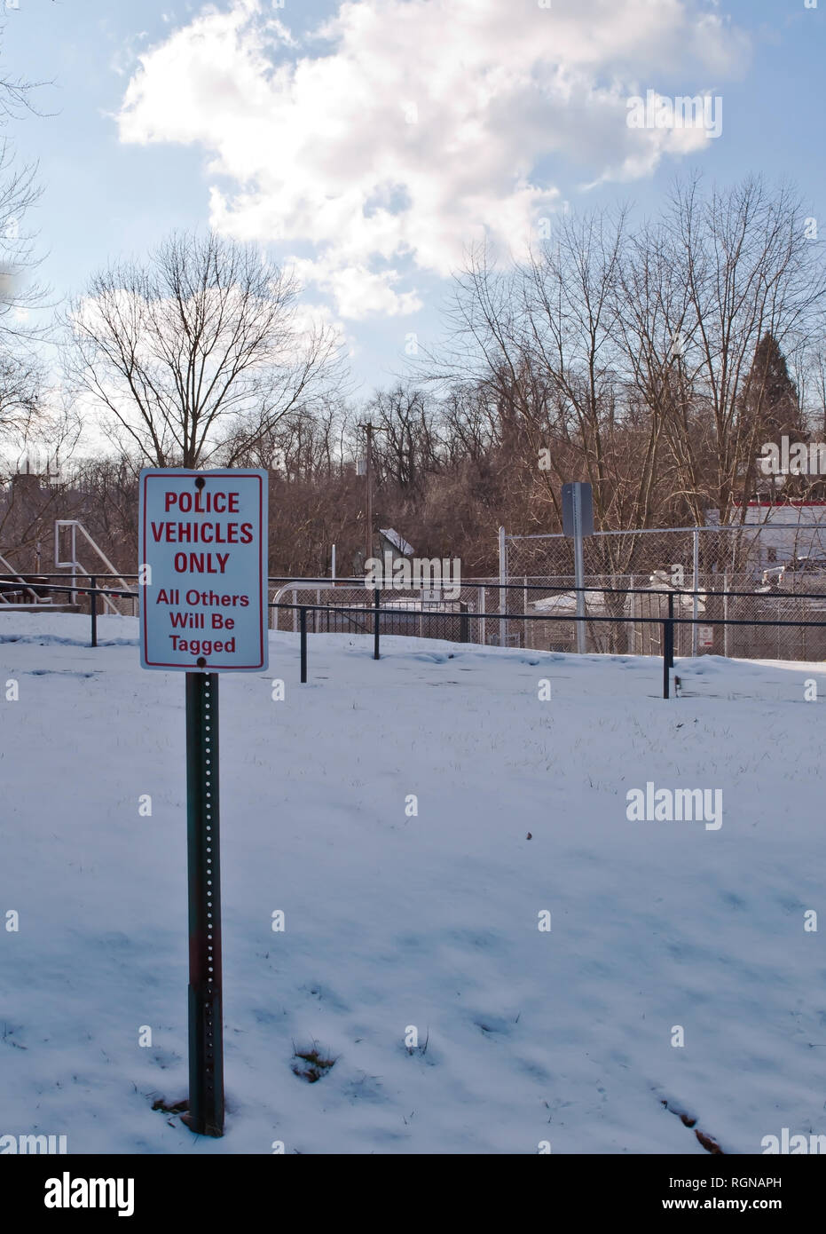 Police only parking sign in winter at the Braddock Hills, Pennsylvania, USA police department - Stock Image