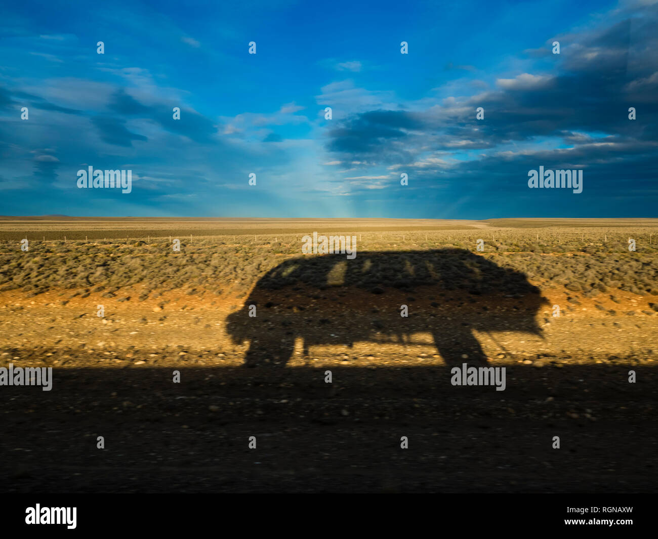 Chile, Patagonia, Shadow of jeep - Stock Image