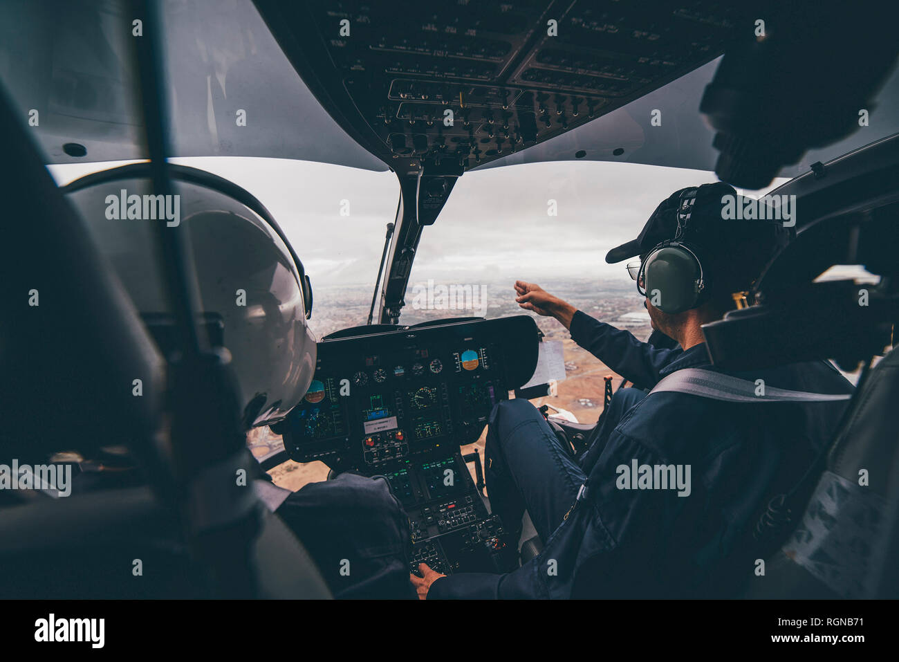 Police pilot during the helicopter flight - Stock Image