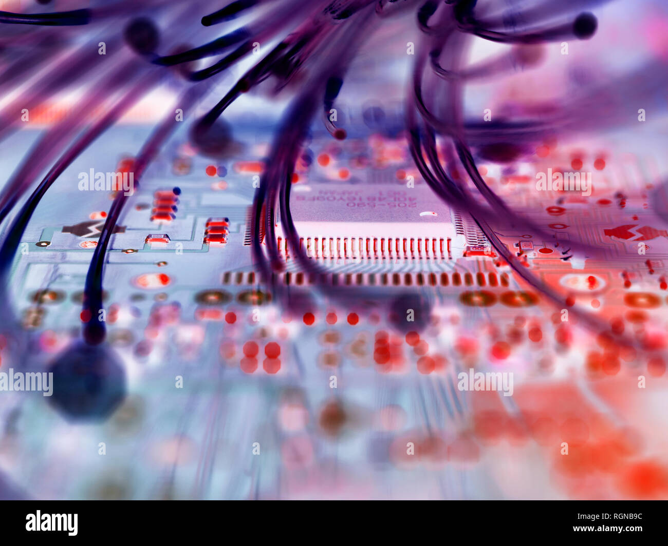 Fibre optics attacking electronic circuit boards with a virus - Stock Image
