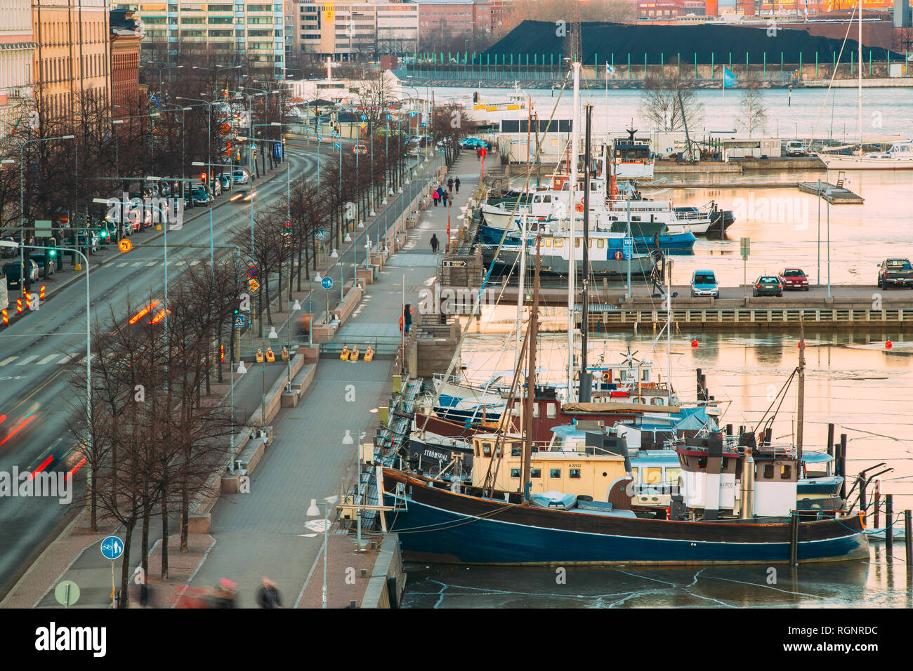 Helsinki, Finland - December 6, 2016: View Of Pohjoisranta Street And Ships, Boats And Yachts Moored Near Pier In Evening Time. - Stock Image
