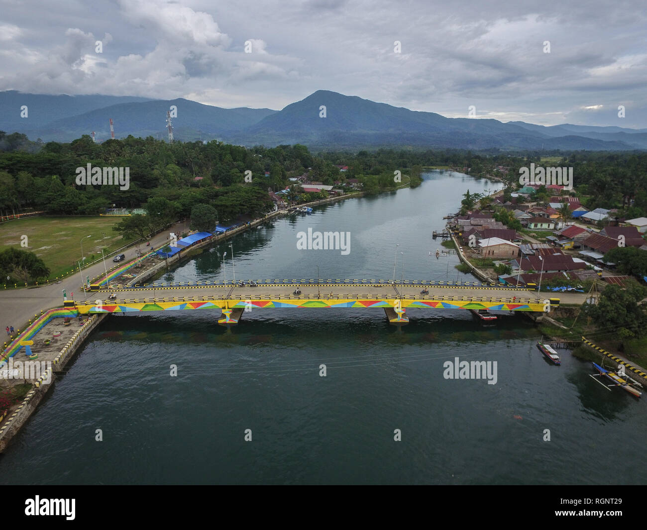 The landscape of Malili River with Verbeek mountain on the background. Malili is a city in South Sulawesi which rely on fishery and agriculture. - Stock Image