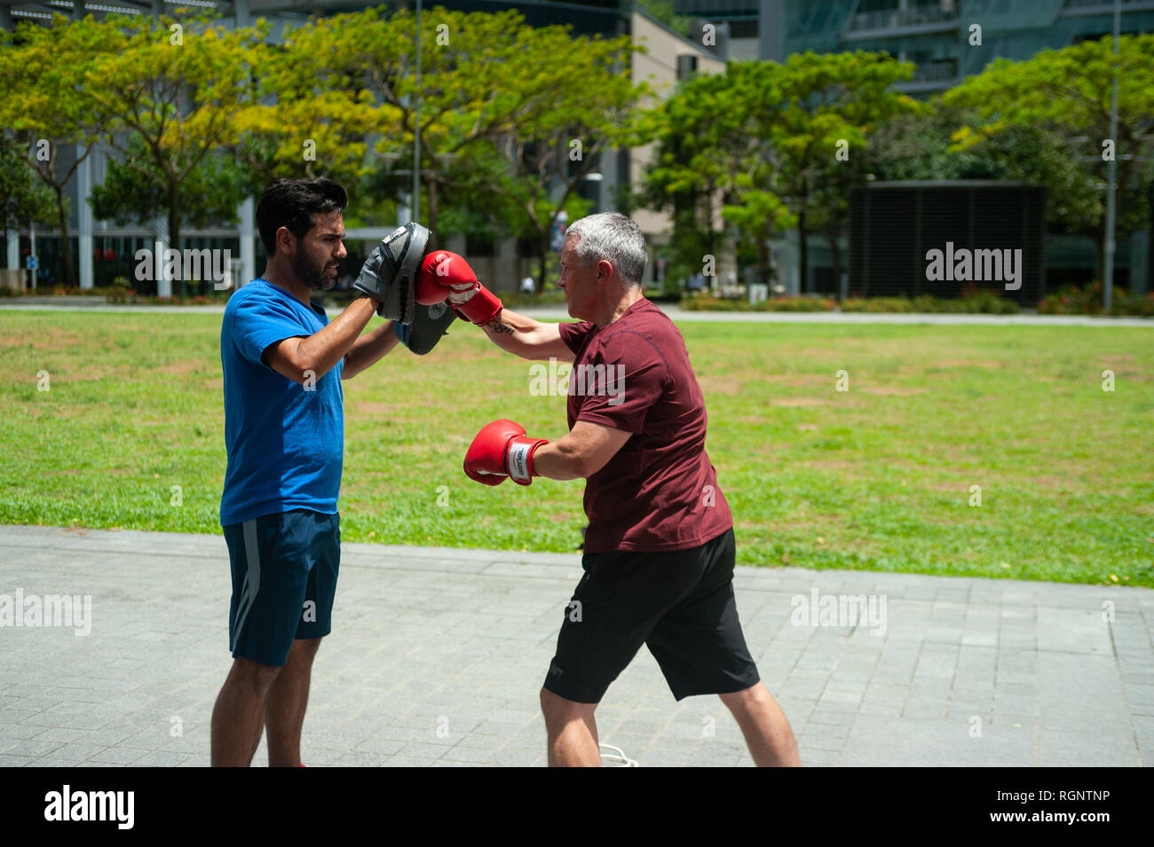 18.04.2018, Singapore, Republic of Singapore, Asia - Two men are seen working out during their lunch break in the central business district. - Stock Image