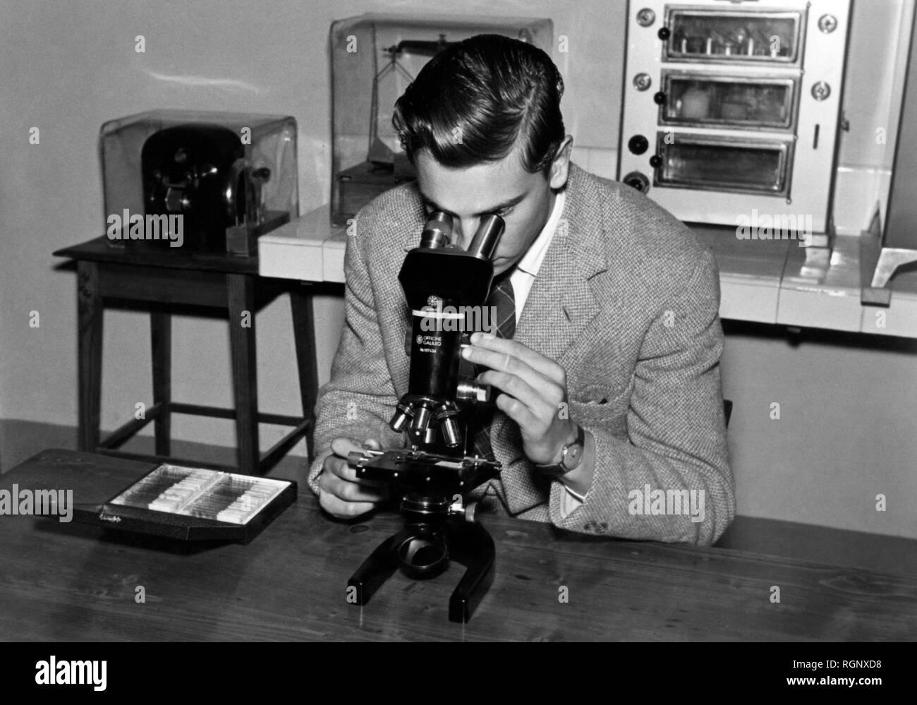 man, microscope, 1957 Stock Photo