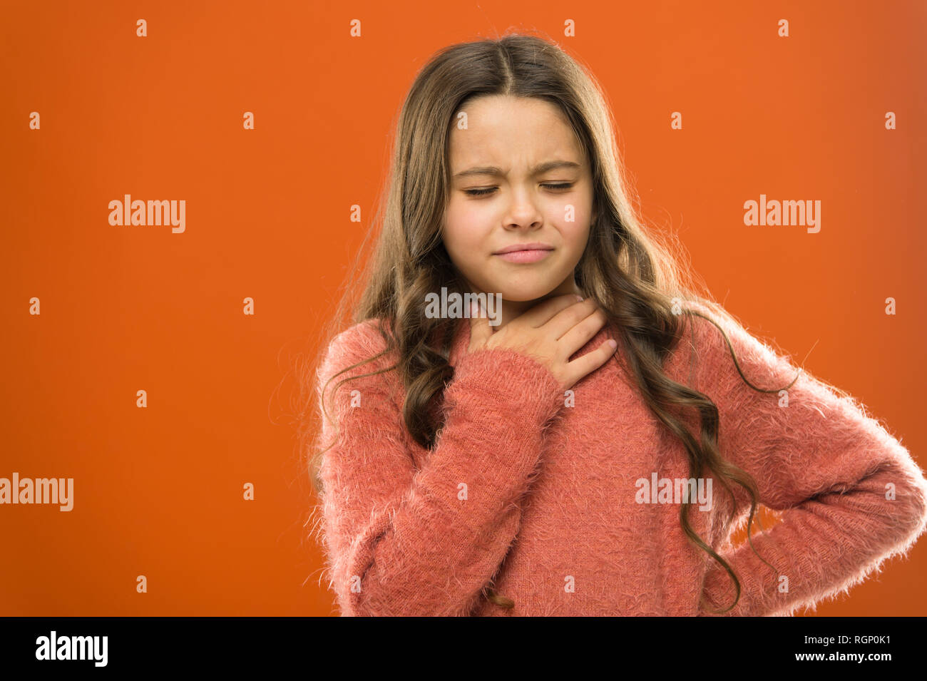 Lost her voice. Sore throat quick remedies. Kid feel pain in throat. Suffer from pain neck. Girl painful face orange background. Health care and medicine. Sore throat remedies. Throat pain treatment. - Stock Image