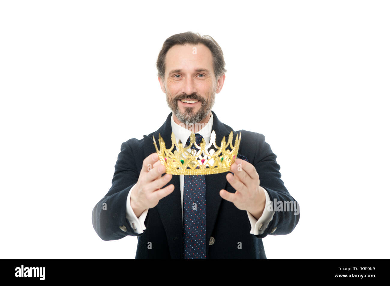 Become king ceremony. King attribute. Become next king. Monarchy family traditions. Man nature bearded guy in suit hold golden crown symbol of monarchy. Direct line to throne. Enormous privilege. - Stock Image