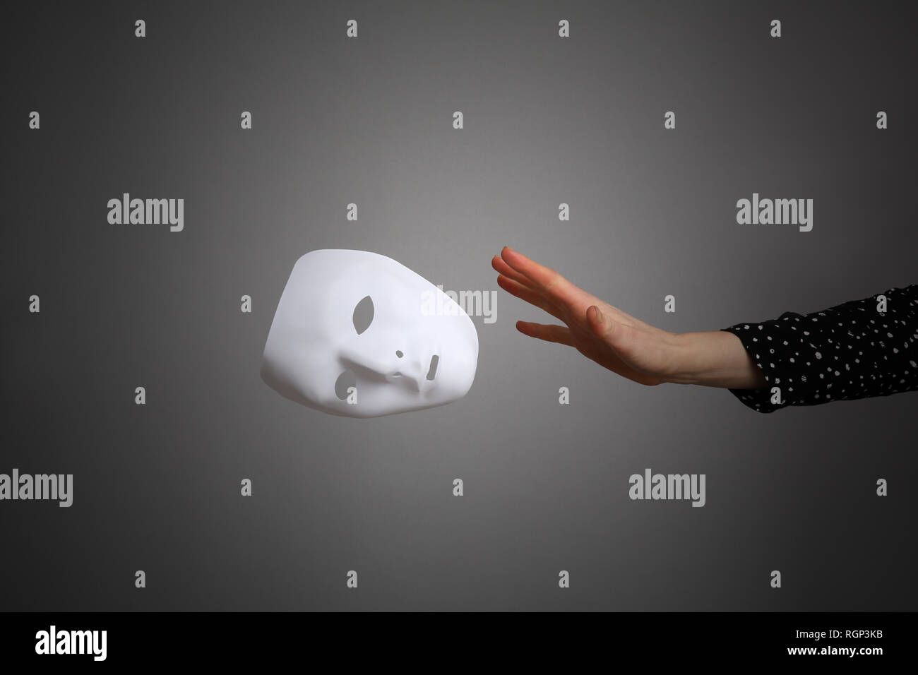The mask is a symbol of duplicity. . - Stock Image