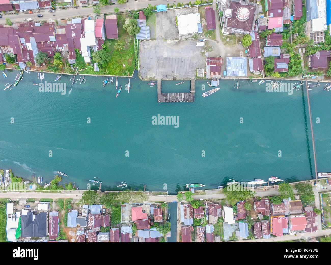 Traditional boat docking in the landscape of Malili River. Malili is asmall city in South Sulawesi which rely on fishery and agriculture. - Stock Image