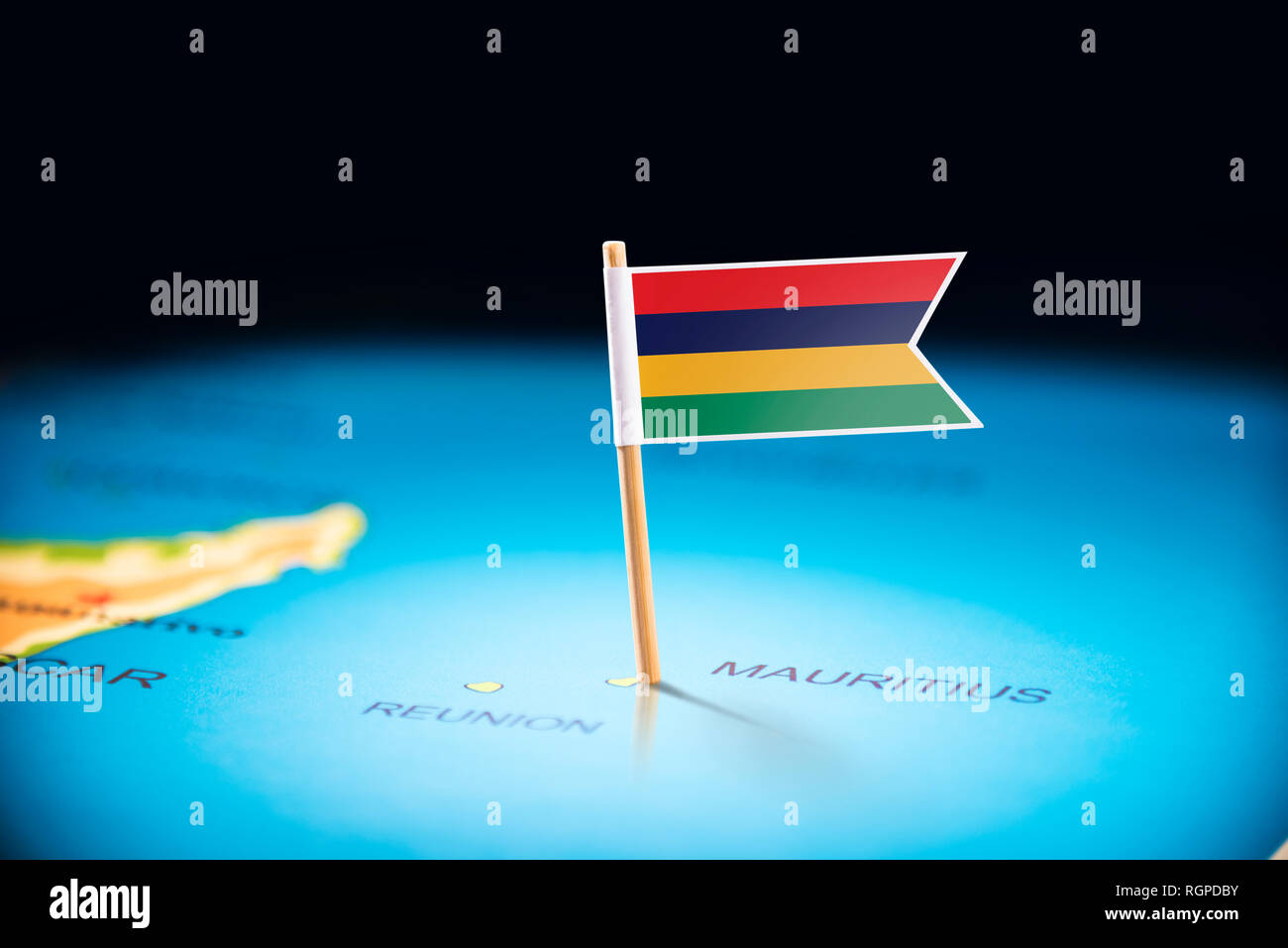 Mauritius marked with a flag on the map Stock Photo