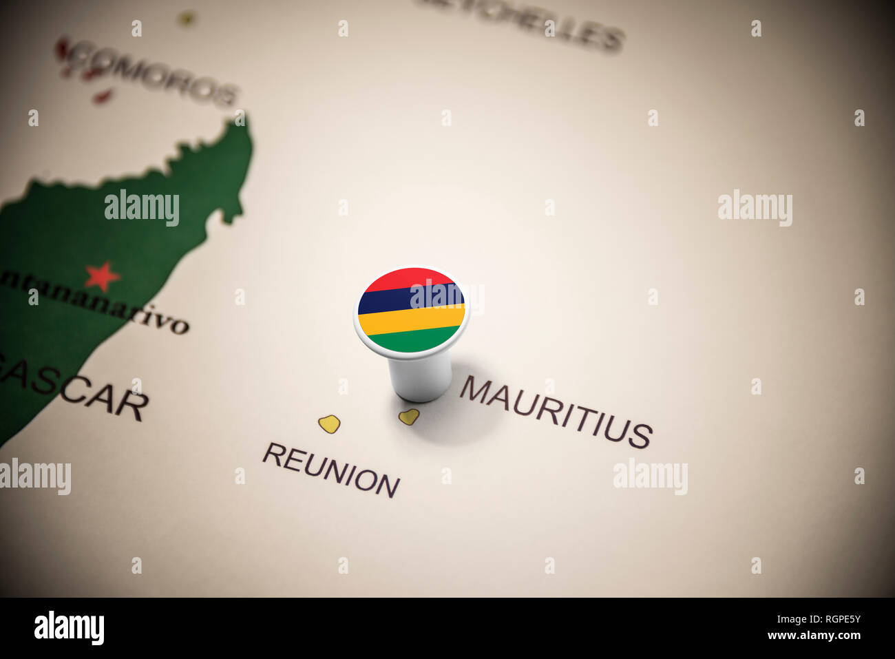 Mauritius marked with a flag on the map - Stock Image