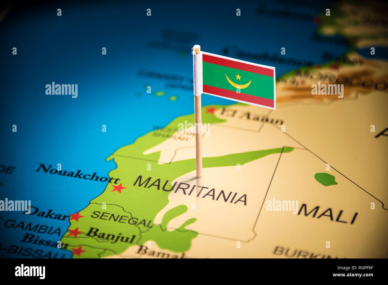 Mauritania marked with a flag on the map - Stock Image