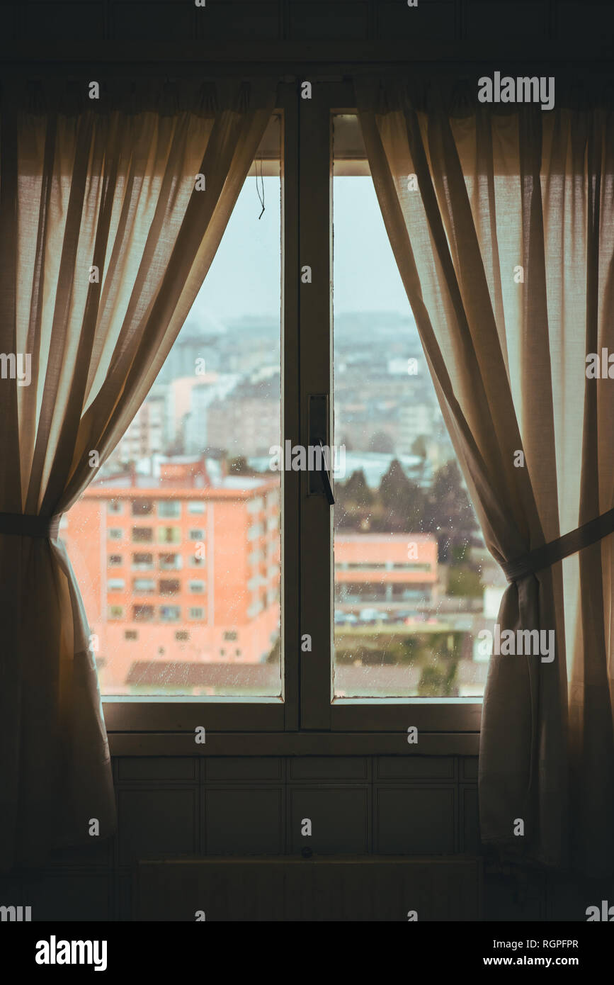 Window With Curtains In Dark Room Of Apartment And Wonderful View Of Town Stock Photo Alamy