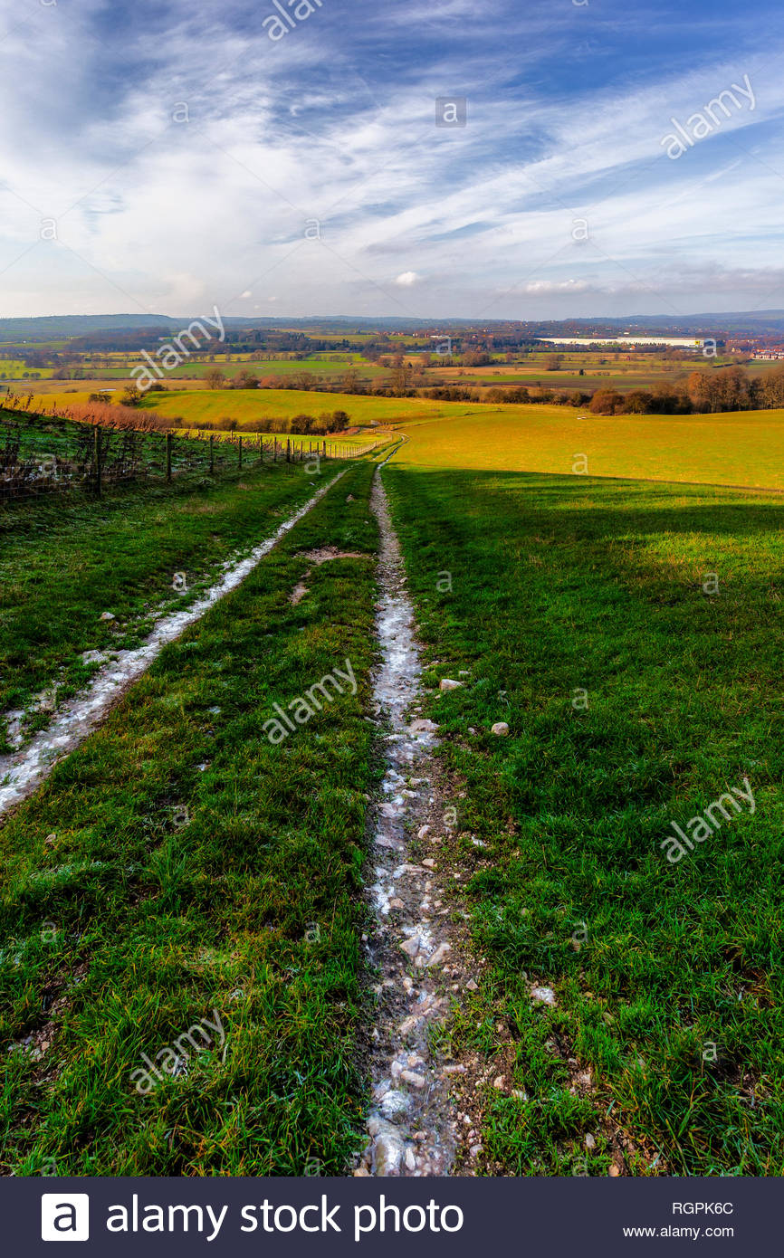 A frozen caterpillar track in the River Dove valley near Combridge and Rocester in Staffordshire - Stock Image