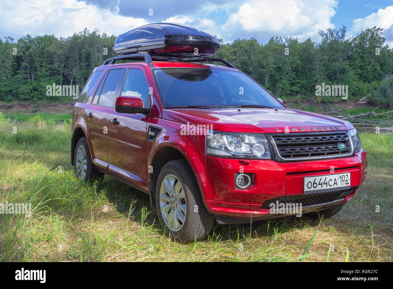 SUV LAND ROVER FREELANDER 2 and TULE autoboxing in the woods on the river bank, a car for traveling. - Stock Image
