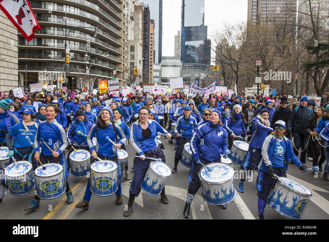 3rd annual Women's March in 2019 in New York City. The New York City-based all-women Brazilian Samba Reggae drum line Fogo Azul (Blue Fire) leads the Women's March across Central Park South in New York City. - Stock Image