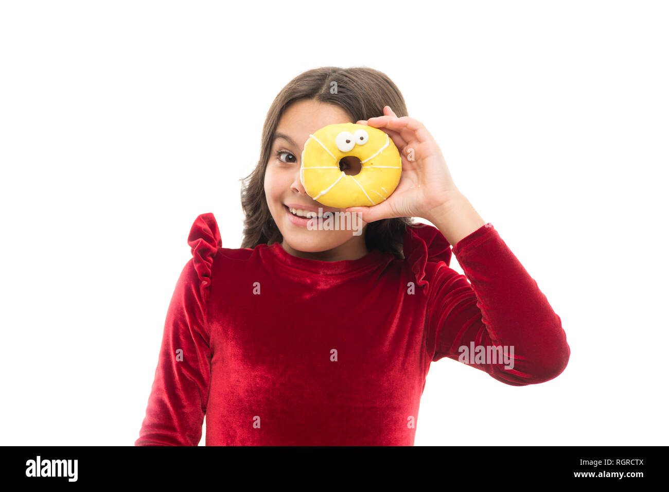 Happy childhood and sweet treats. Breaking diet concept. Girl hold sweet donut white background. Child hungry for sweet donut. Sugar levels and healthy nutrition. Nutritionist advice. Sweet obsession. - Stock Image