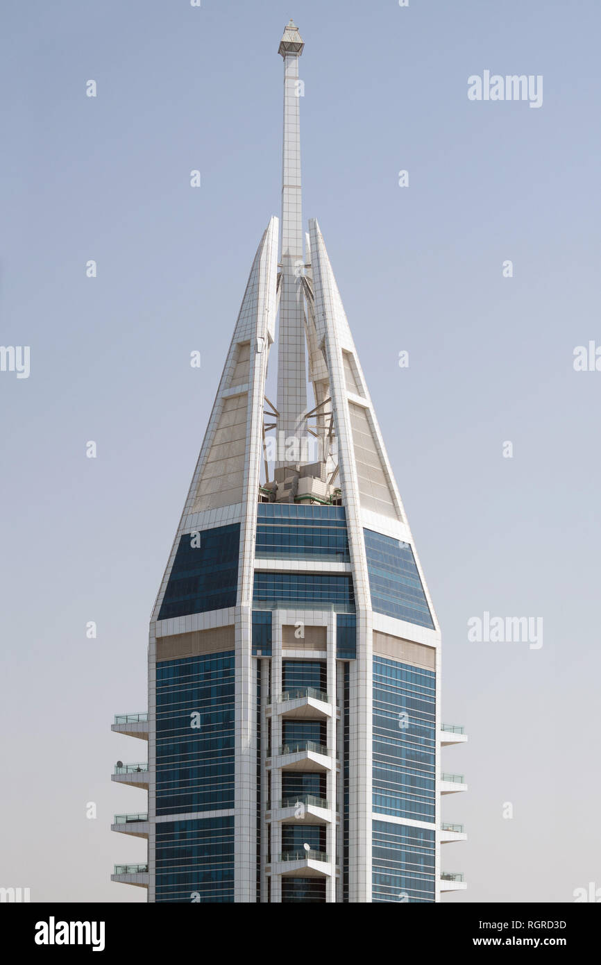DUBAI, UAE - February 16, 2018: Top of The 23 Marina Tower, a 89 story residential skyscraper in the Dubai Marina area of Dubai, UAE - Stock Image