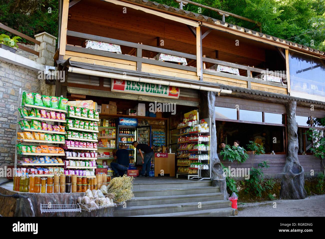 Sale of goods and restaurant, Uji i Ftothe, Albania - Stock Image