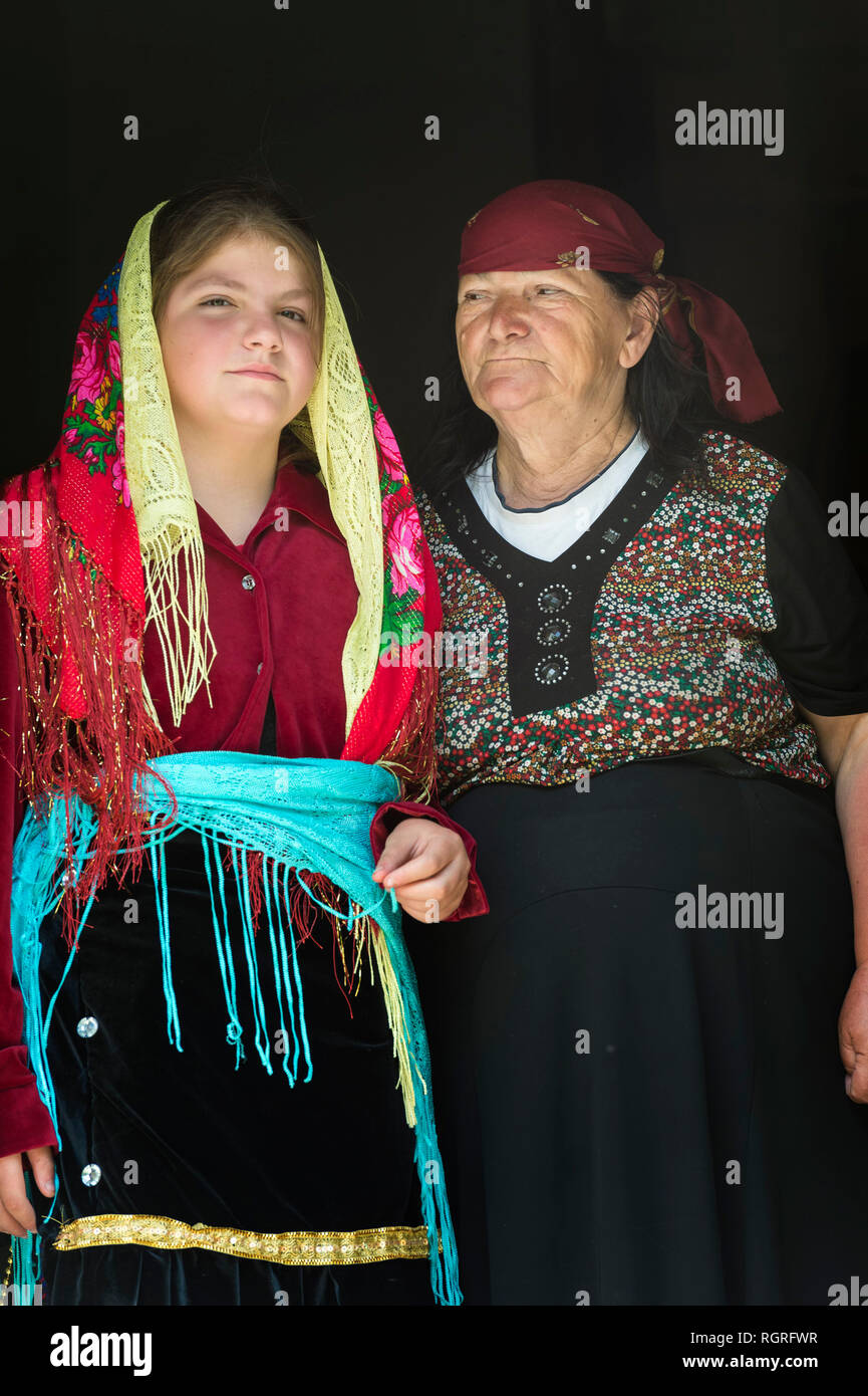 Grandmother and granddaughter in traditional clothing, Thethi village, Thethi valley, Albania - Stock Image