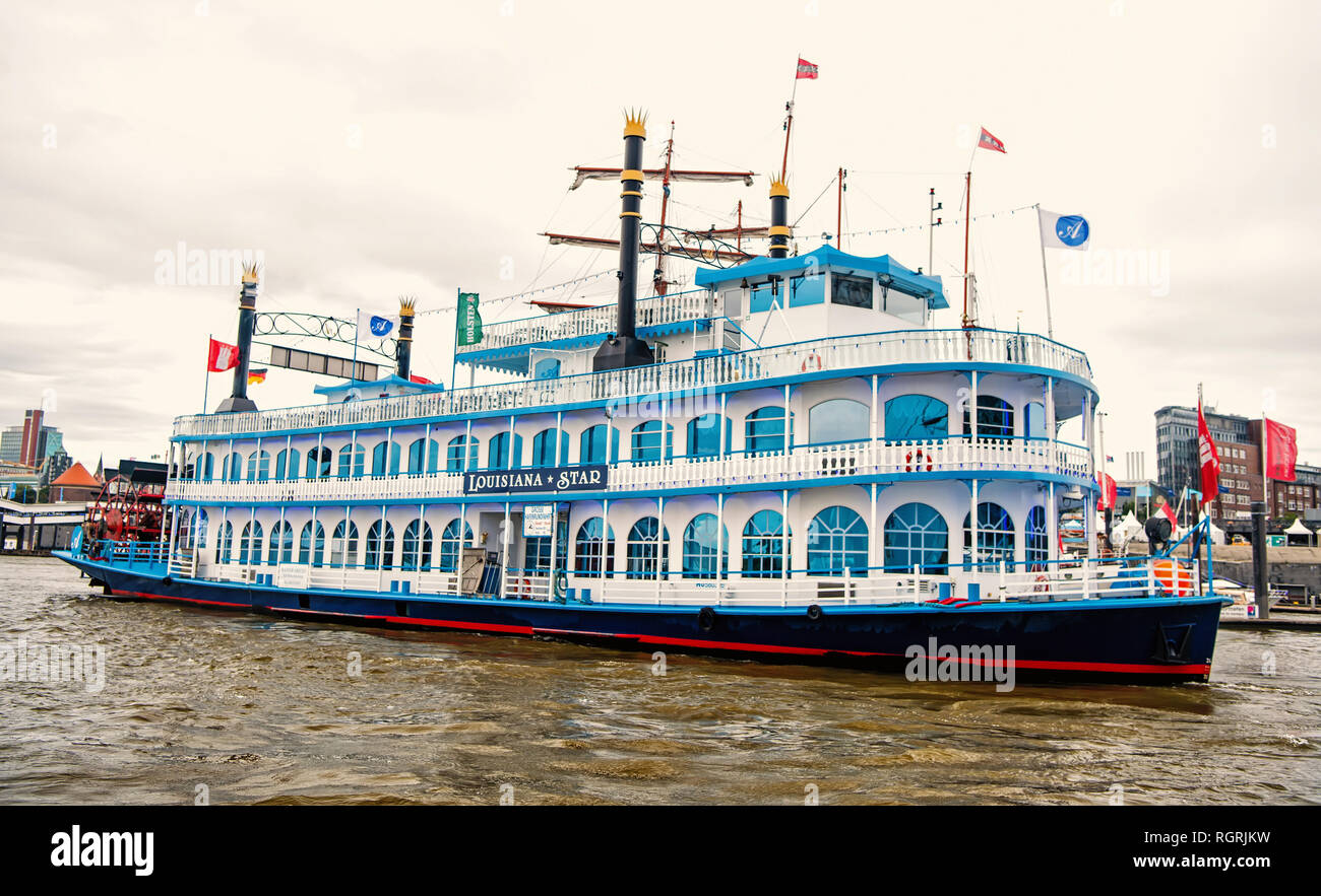 Hamburg, Germany - September 07, 2017: Travel, travelling, trip. Old ship float on water in city harbor. Retro, vintage vessel transport transportation Vacation discovery wanderlust - Stock Image