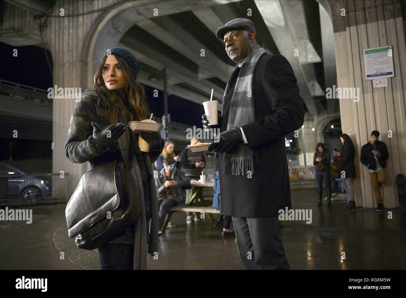 Sarah Shahi & Dennis Haysbert Television: Reverie (2018)  Character(s): Mara Kint, Charlie Ventana  30 May 2018  SAX92427 Allstar Picture Library/UNIVERSAL TELEVISION  **Warning**  This Photograph is for editorial use only and is the copyright of UNIVERSAL TELEVISION  and/or the Photographer assigned by the TV or Production Company & can only be reproduced by publications in conjunction with the promotion of the above TV Programme. A Mandatory Credit To UNIVERSAL TELEVISION is required. The Photographer should also be credited when known. No commercial use can be granted without written author - Stock Image