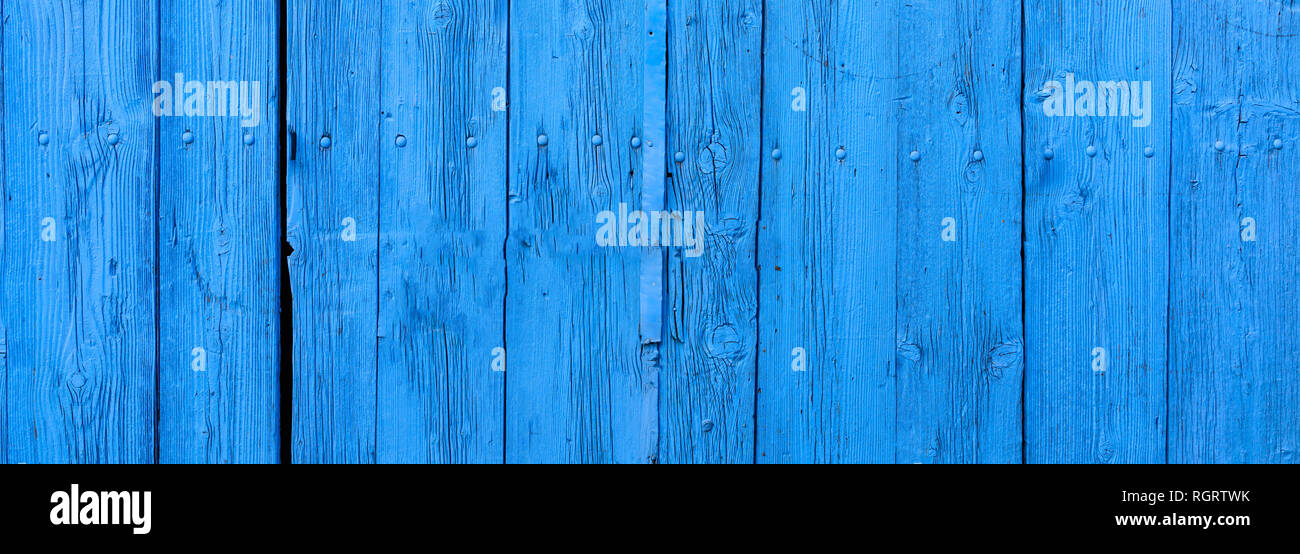 Wood blue board background, texture. Wooden planks, blue color painted, with nails, floor or wall, banner - Stock Image