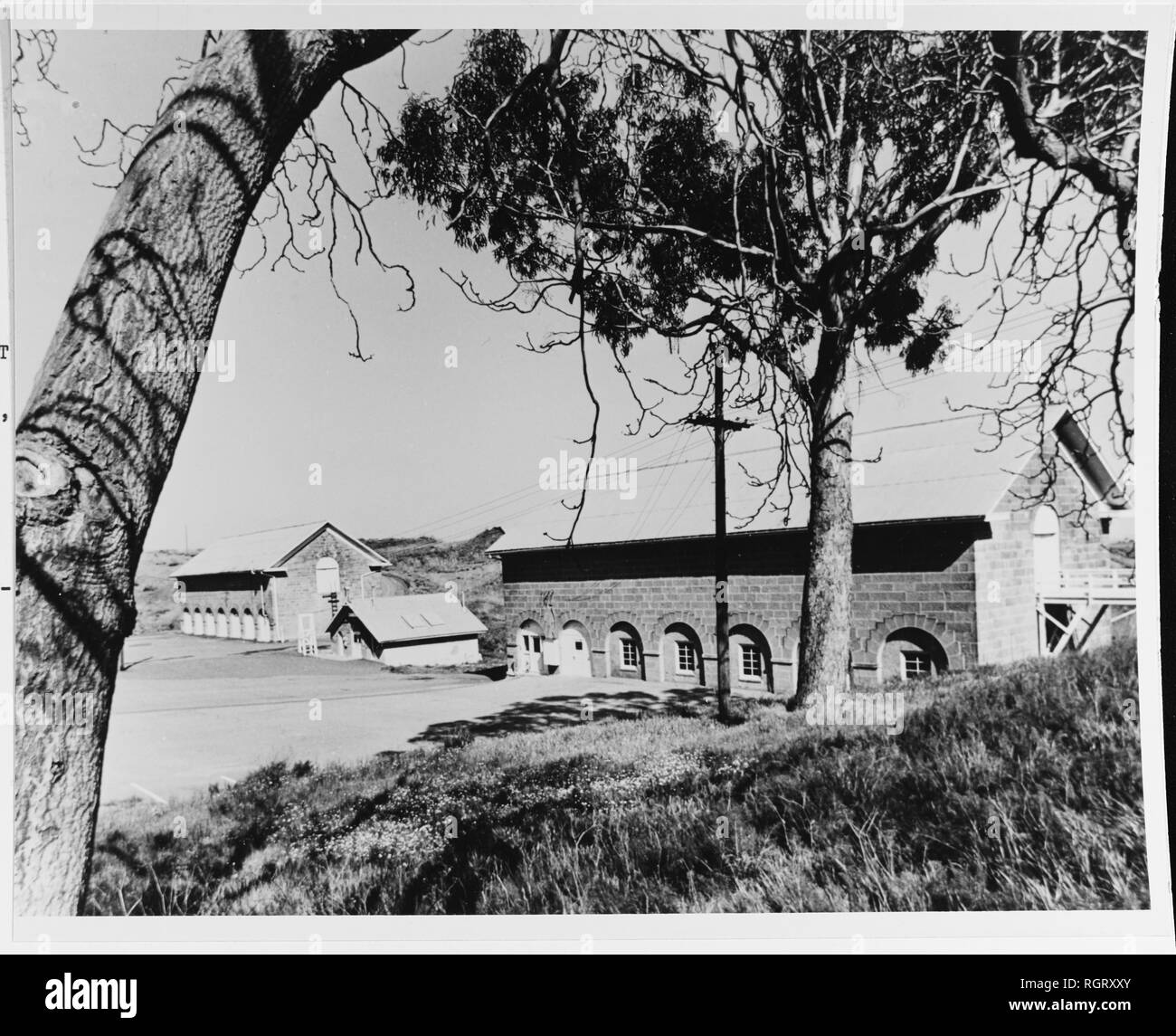 Camel barns at the Benicia Arsenal, photographed in September 1967 by Aero Photographers of Sausalito, California. In the 1850s the U.S. Government brought dromedaries to the West for experimentation in logistics. Lieutenant Edward F. Beale, USN, used them in survey work. In November 1863 thirty-four of the animals were moved from southern California to the Naval Arsenal at Benicia, where they were sold at auction on 26 February 1864. This photograph shows the buildings in which they were kept. Whether the buildings have been bricked over, or restored, is unknown.  Courtesy of Benicia Industri - Stock Image