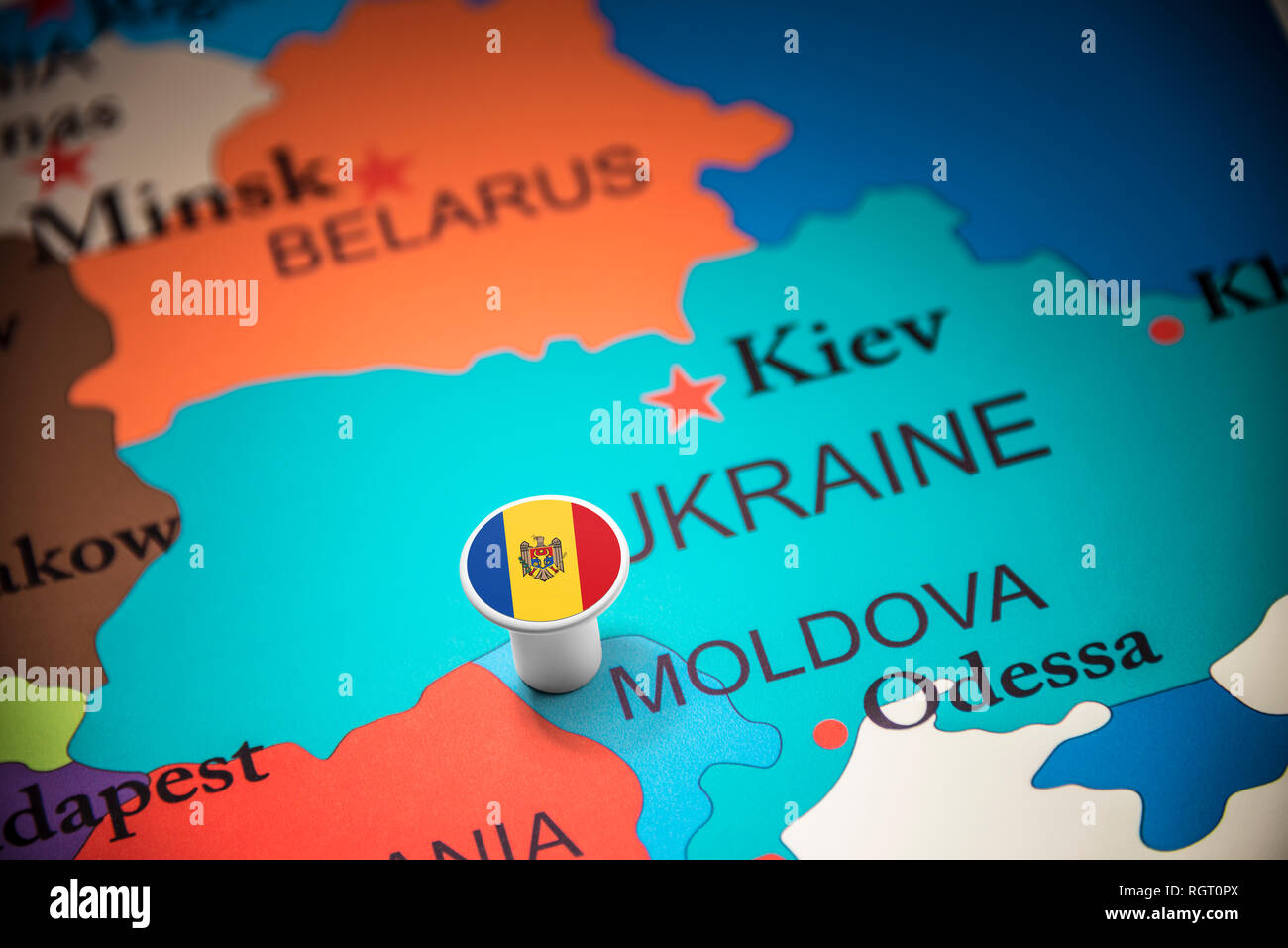 Moldova marked with a flag on the map - Stock Image