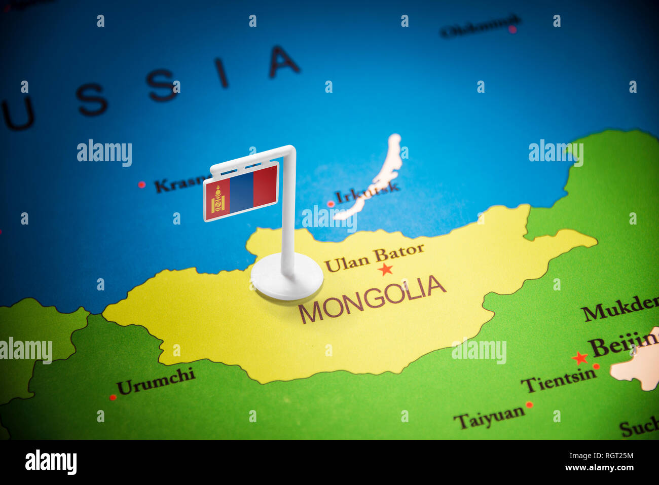 Mongolia marked with a flag on the map - Stock Image
