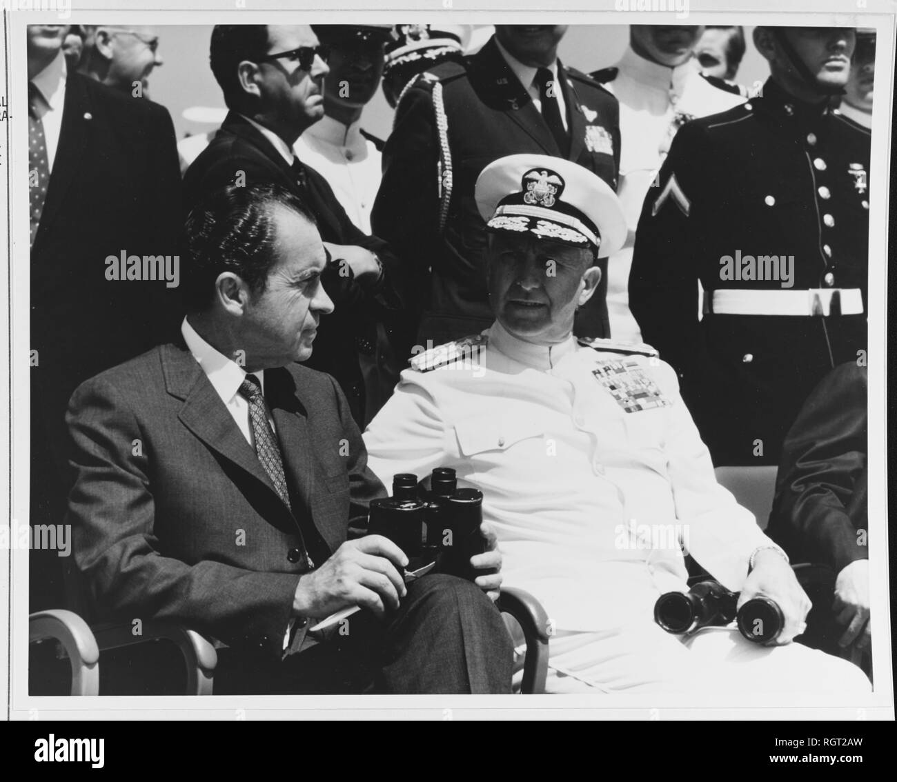 Photo #: K-72713  President Richard M. Nixon (left), with , Chief of Naval Operations  Witness air and sea power demonstrations from the flight deck of USS Saratoga (CVA-60), in the Atlantic Ocean, May 1969. Photographed by PH3 Philip J. Fraga.  Official U.S. Navy Photograph. Stock Photo