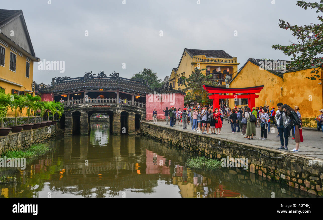 Hoi An, Vietnam - Jan 20, 2019. Tourists visit Bridge Pagoda (Chua Cau) in Hoi An Old Town, Vietnam. - Stock Image