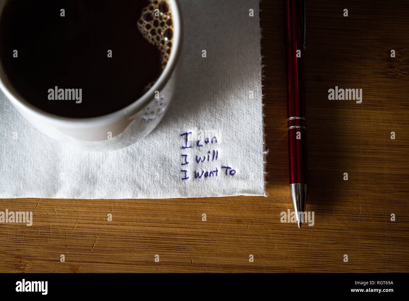 hand written note on a coffee stained napkin with an empowering message, I can I will I want to. - Stock Image