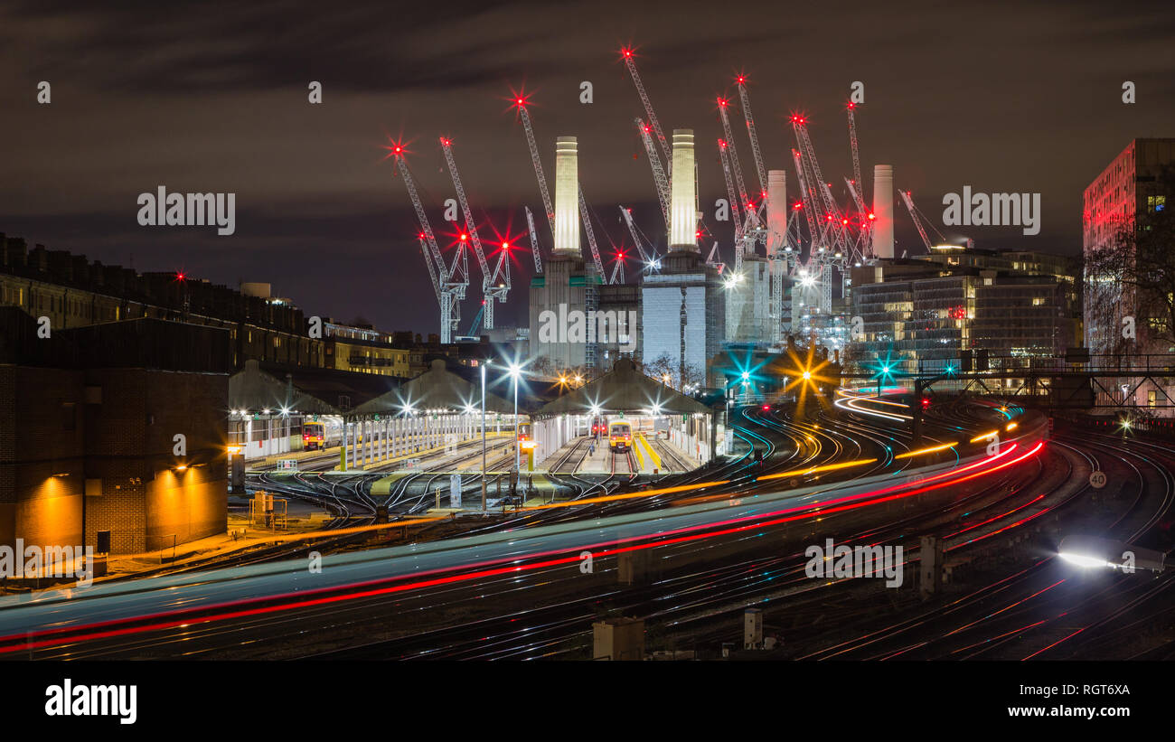 The view from Ebury Bridge of the train's light trails and Battersea