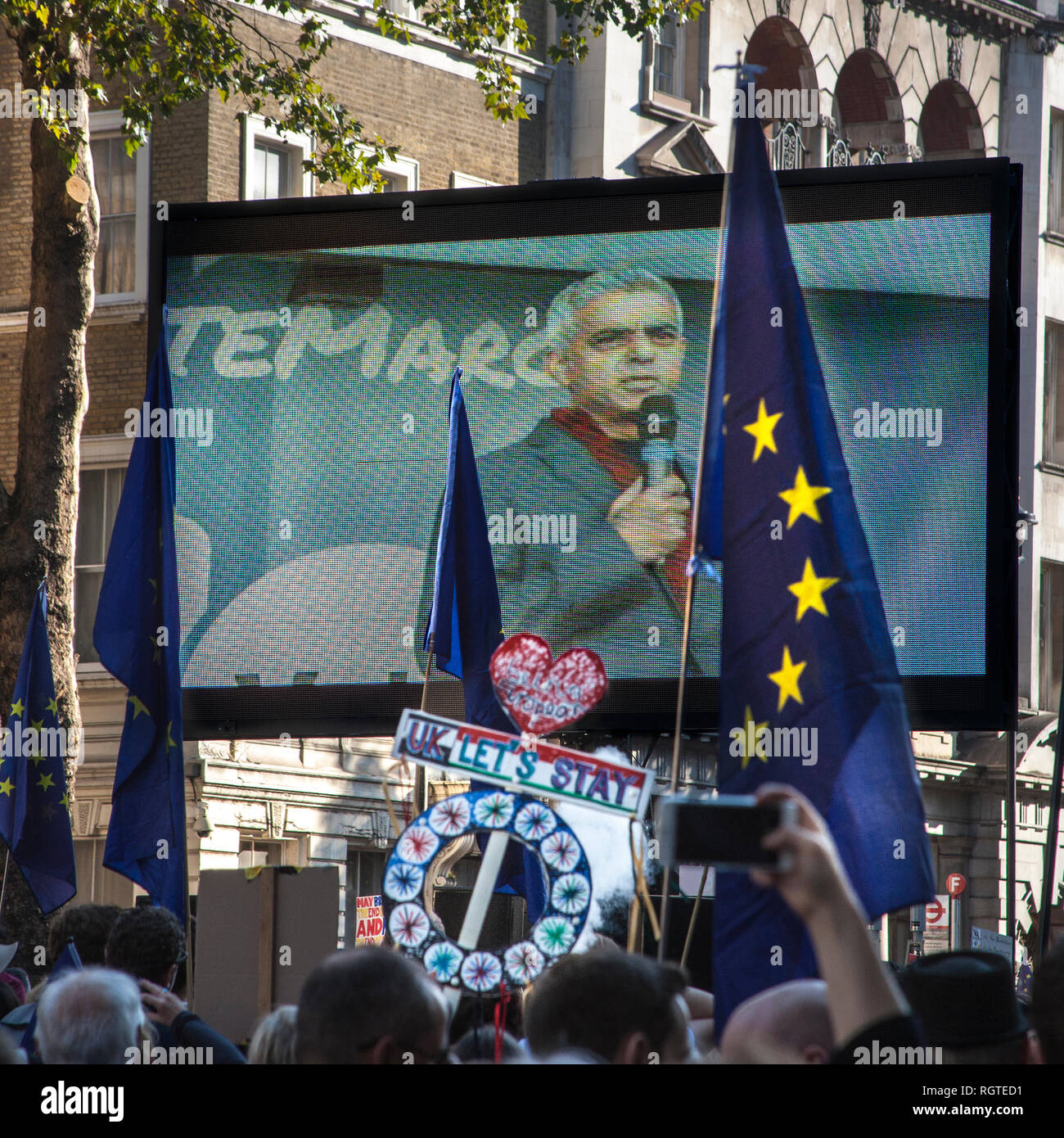Sadiq Khan on tv screen at people's vote march London - Stock Image