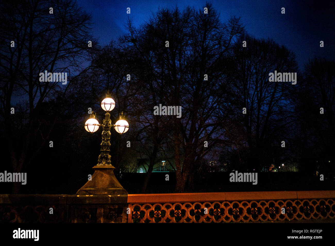 Gloucester Gate Bridge elaborate bronze candelabra shot at night Gloucester gate victorian street lamps regents park royal parks camden - Stock Image