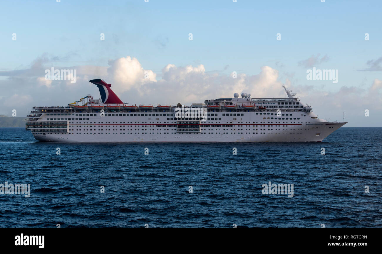 Carnival Fascination Cruise Ship leaving St. Kitts, Caribbean Sea - Stock Image