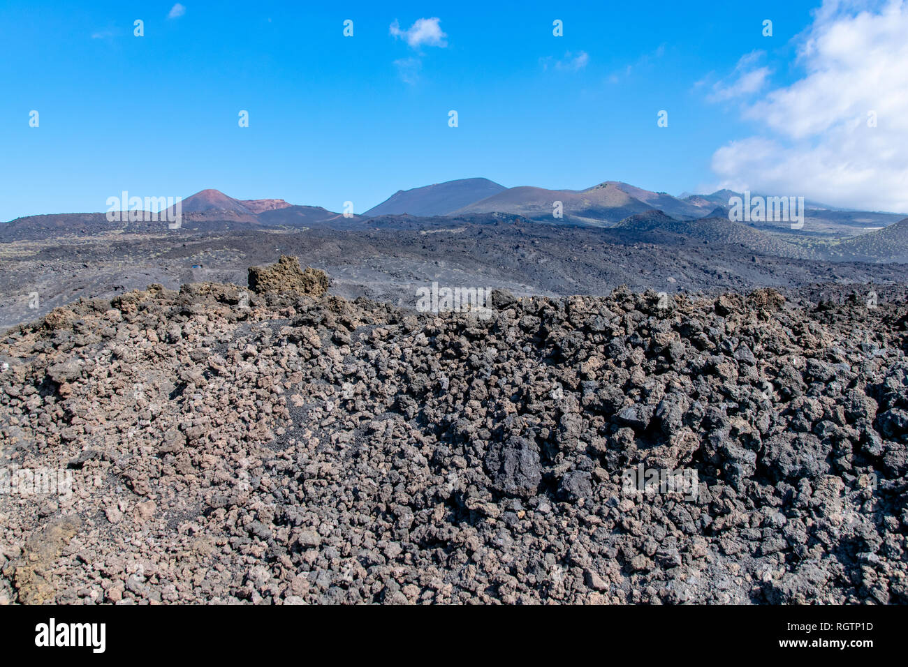 Edge of the volcanic lava field with Teneguia volcano in the background La Palma Island, Canaries, Spain - Stock Image