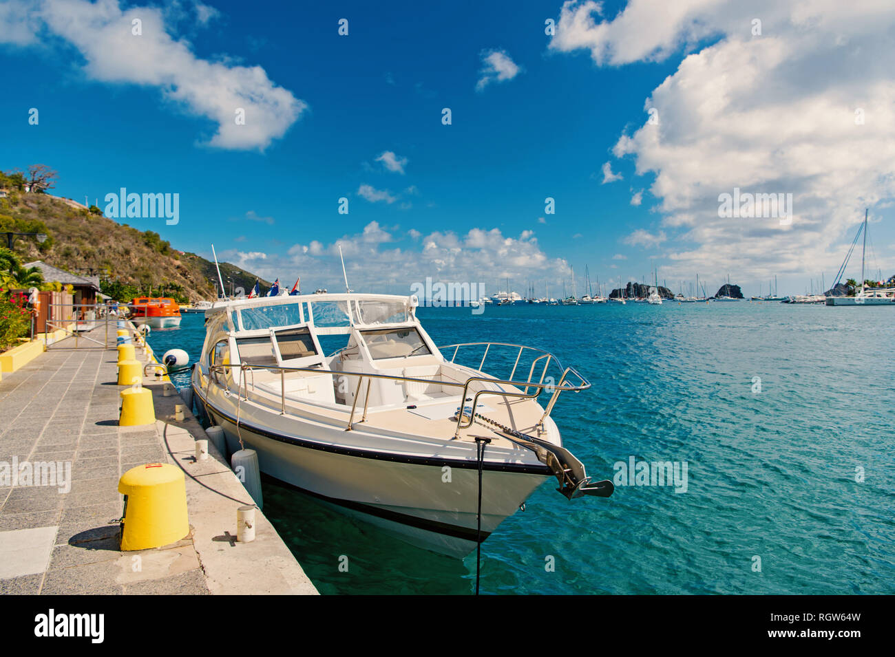 Yacht boat anchored at sea pier on tropical beach in gustavia, st.barts. Yachting and sailing. Luxury travel on boat. Summer vacation on island. Water transport and marine vessel. - Stock Image
