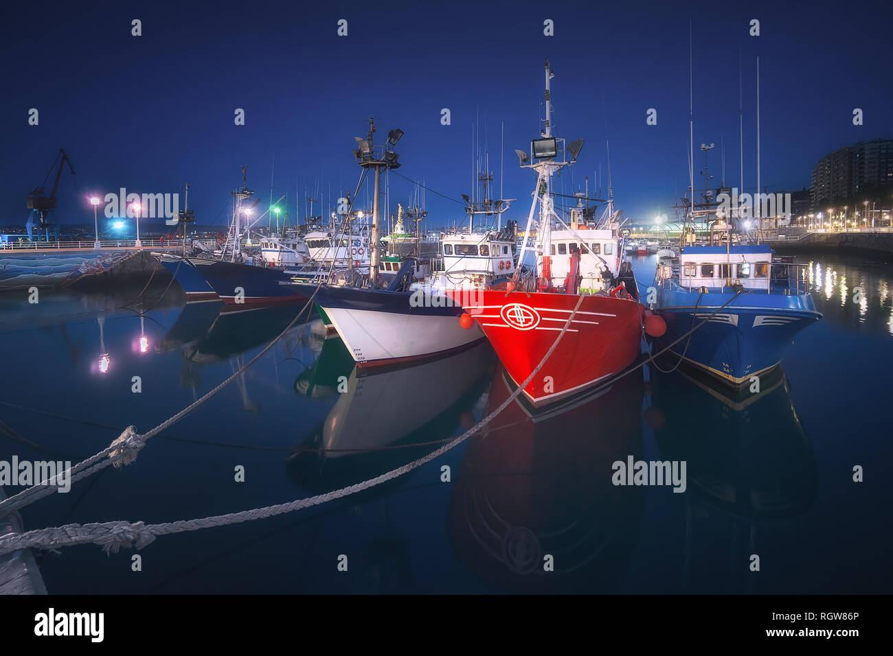 Fishing ships in Santurce port at night - Stock Image