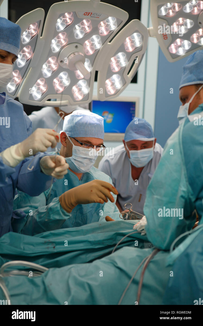 surgeons in total hip replacement surgery - Stock Image
