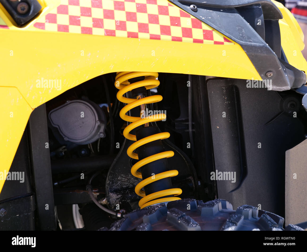 Details of a yellow coil spring attached to a safety and transport vehicle on the beach of the Yanchep, an Australian suburb north of Perth. Stock Photo