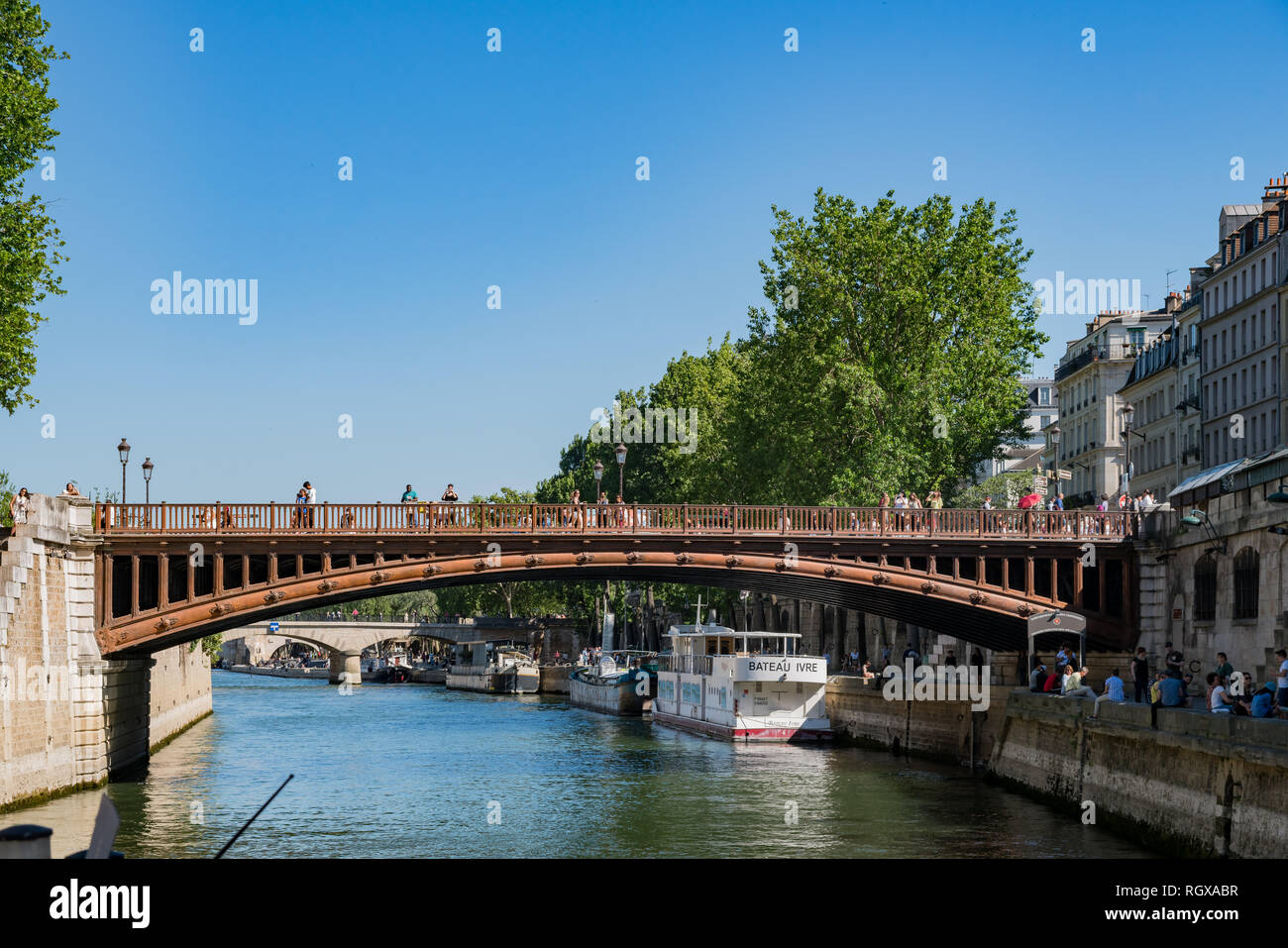 Paris, MAY 7: Pont au Double bridge and Seine river view on MAY 7, 2018 at Paris, France - Stock Image