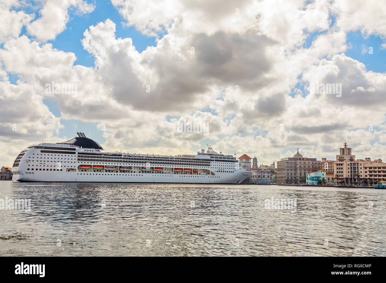 Big touristic cruise ship docked in port of Havana with blue sky and clouds panorama, Cuba - Stock Image