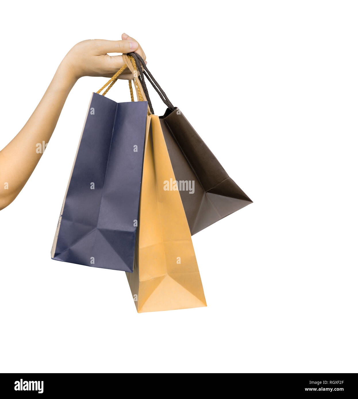 Woman carrying paper shopping bags isolated on white background. Adult woman  hand hold three shopping e19f6e2d777d3