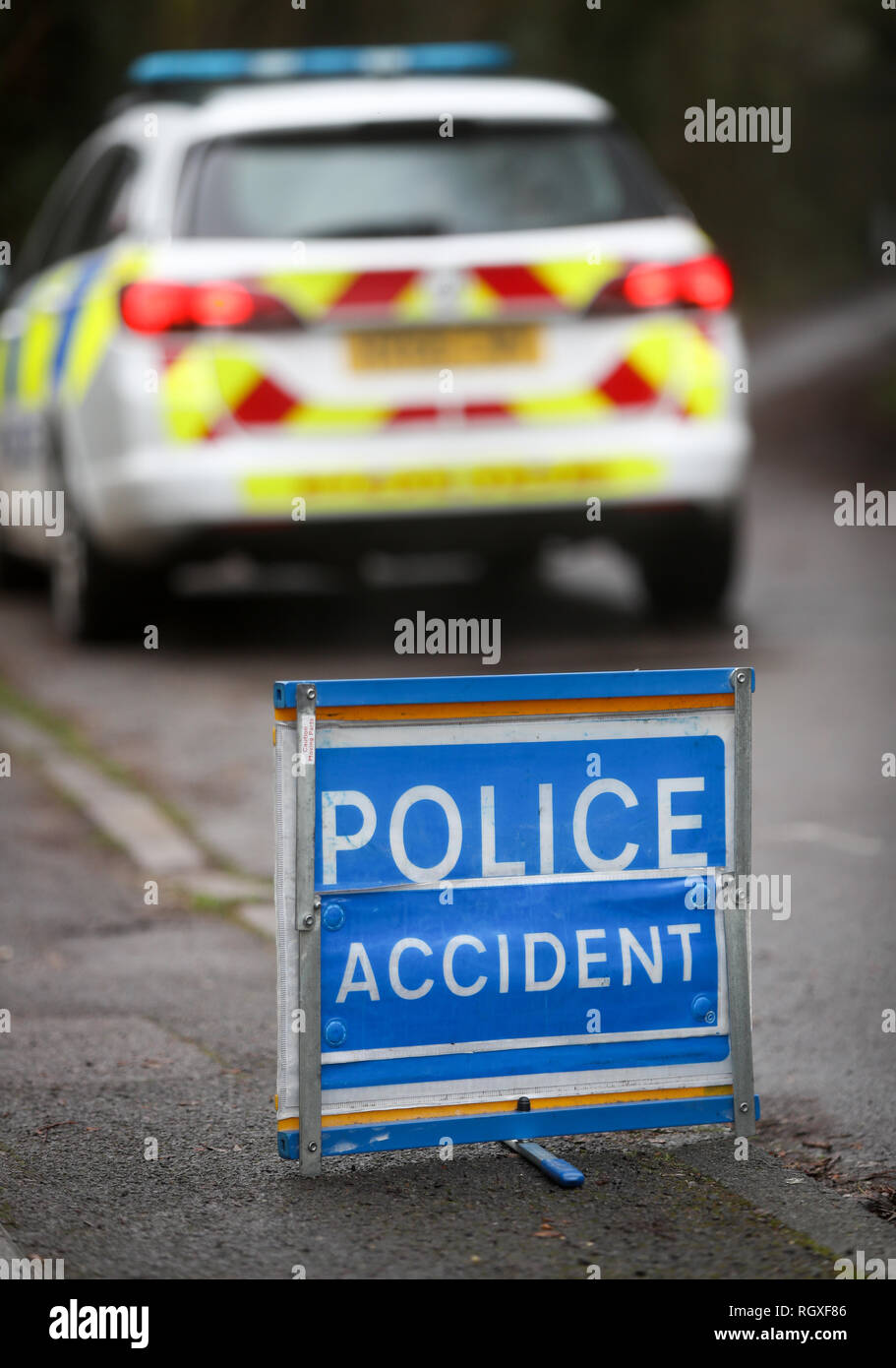 Police accident road sign and police car on a country lane at the scene of an accident - Stock Image