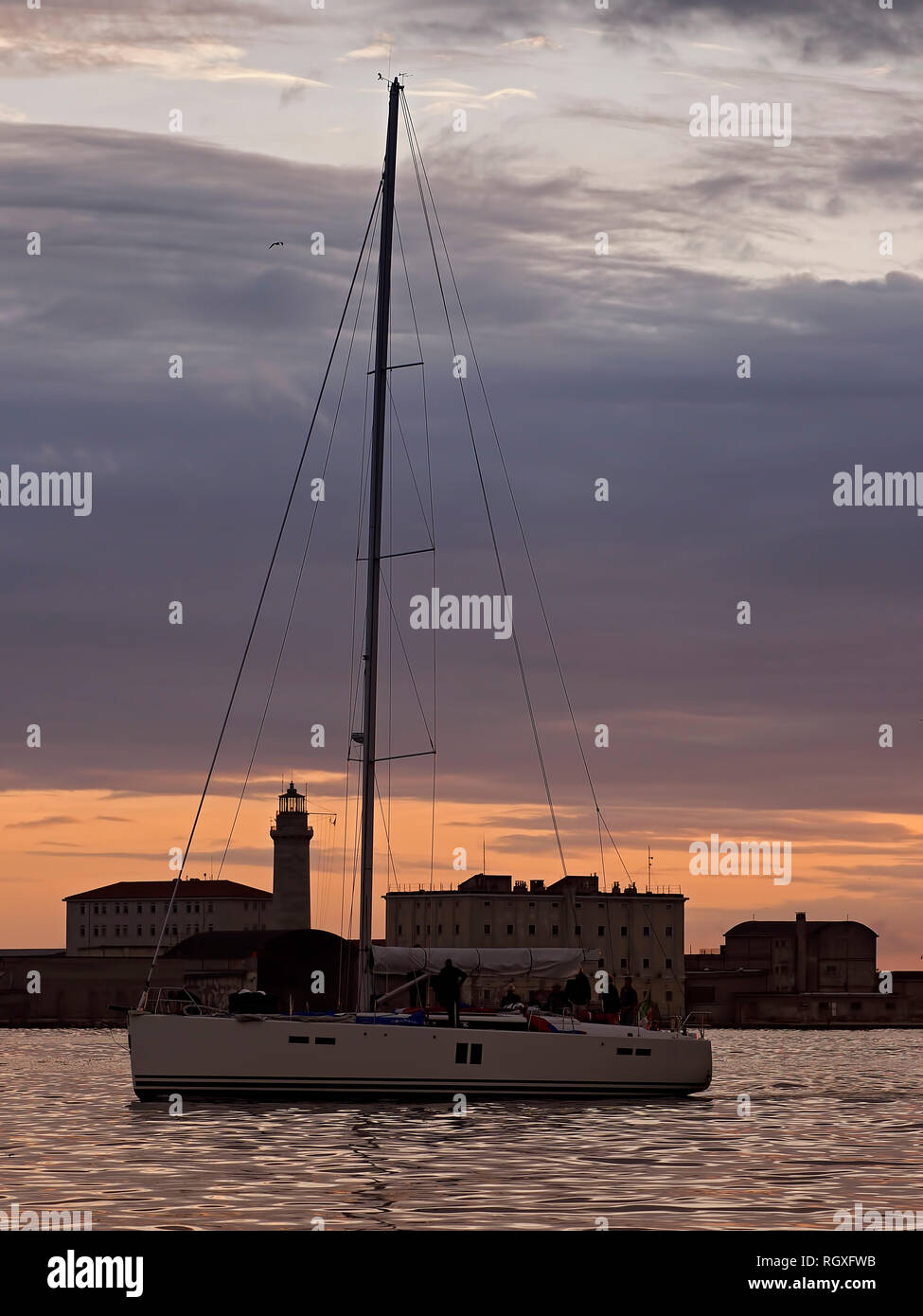 Trieste. Italy. Sailing boat and the Lantern. Stock Photo