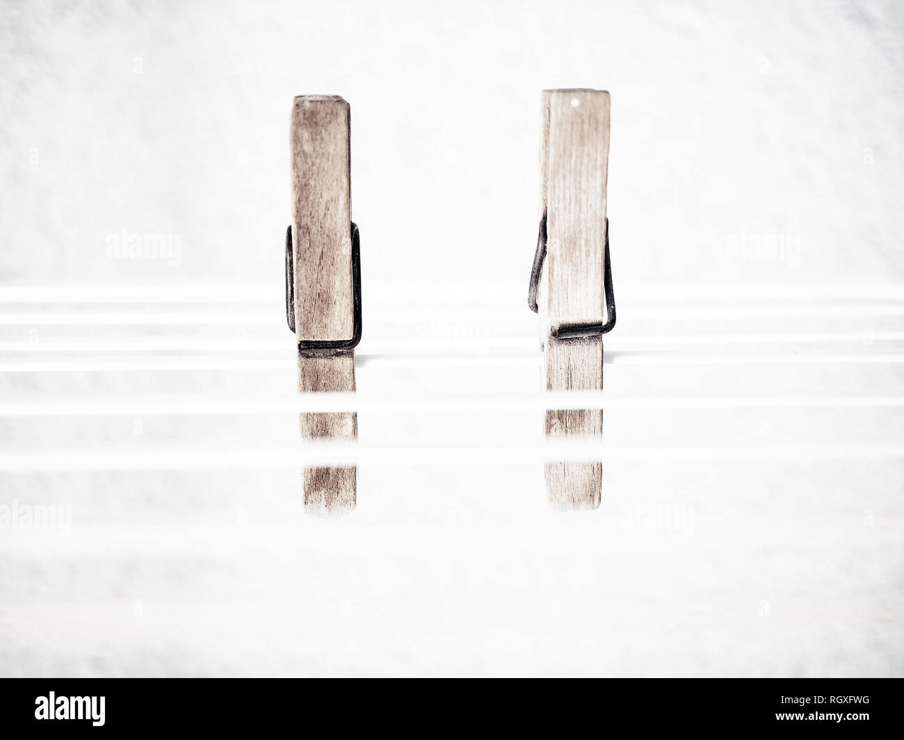 Two clothespins on the rope. Ready for the bowing. Stock Photo